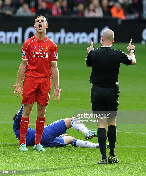 Jordan Henderson of Liverpool is spoken to by Referee Anthony Taylor during the Barclays Premier League match between Liverpool and Chelsea at...
