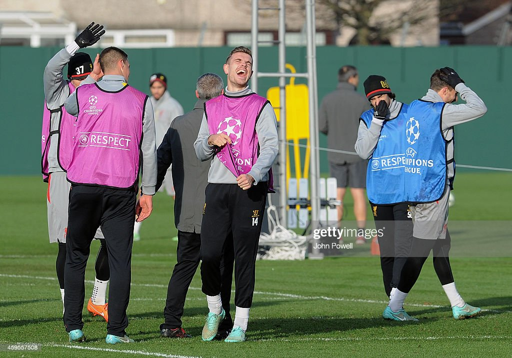 Jordan Henderson of Liverpool laughing during a training session prior the match between PFC Ludogorets Razgrad and Liverpool at Melwood Training Ground on November 25, 2014 in Liverpool, England.