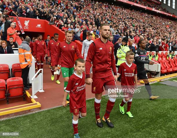 Jordan Henderson of Liverpool leads his team out before the Premier League match between Liverpool and Crystal Palace at Anfield on August 19 2017 in...