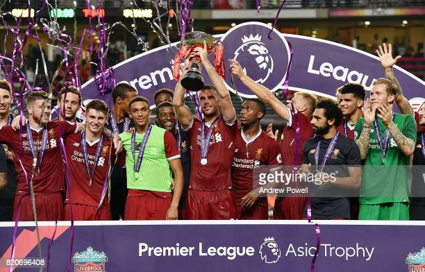 Jordan Henderson of Liverpool lifts the Premier League Asia Trophy after winning the Premier League Asia Trophy match between Liverpool FC and...