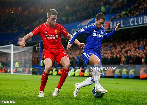 Jordan Henderson of Liverpool marshalls Eden Hazard of Chelsea during the Capital One Cup SemiFinal second leg between Chelsea and Liverpool at...