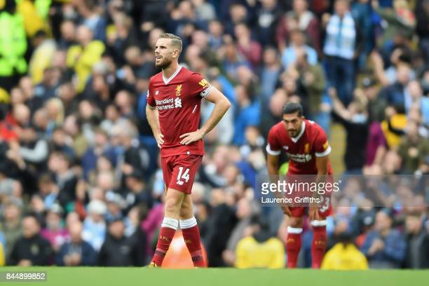 Jordan Henderson of Liverpool reacts during the Premier League match between Manchester City and Liverpool at Etihad Stadium on September 9 2017 in...