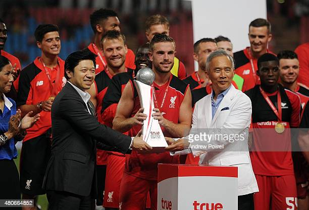 Jordan Henderson of Liverpool receiving the trophy after winning the international friendly match between Thai Premier League All Stars and Liverpool...