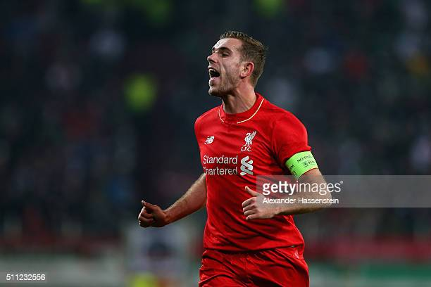 Jordan Henderson of Liverpool runs with the ball during the UEFA Europa League round of 32 first leg match between FC Augsburg and Liverpool at...