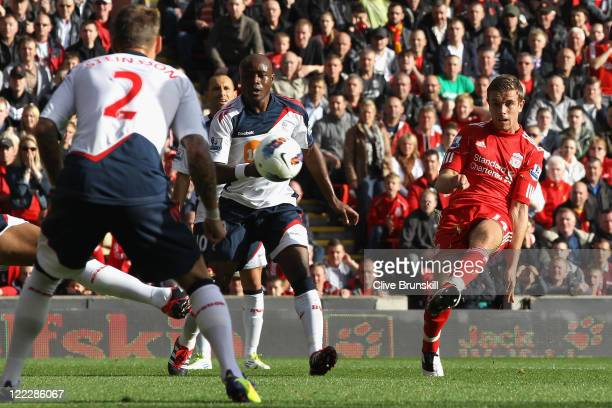 Jordan Henderson of Liverpool scores the opening goal during the Barclays Premier League match between Liverpool and Bolton Wanderers at Anfield on...