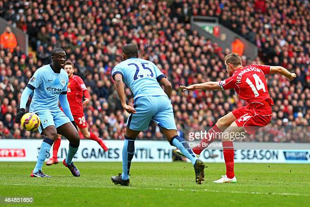 Jordan Henderson of Liverpool scores the opening goal during the Barclays Premier League match between Liverpool and Manchester City at Anfield on...