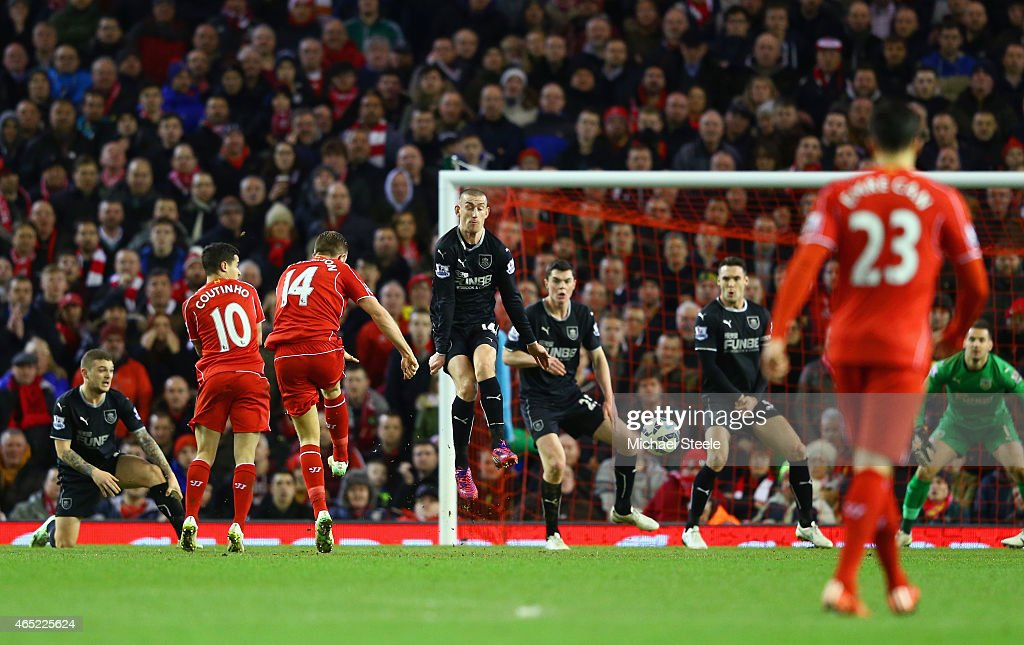 <a gi-track='captionPersonalityLinkClicked' href=/galleries/search?phrase=Jordan+Henderson&family=editorial&specificpeople=4940390 ng-click='$event.stopPropagation()'>Jordan Henderson</a> of Liverpool scores the opening goal during the Barclays Premier League match between Liverpool and Burnley at Anfield on March 4, 2015 in Liverpool, England.