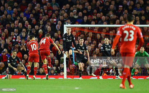 Jordan Henderson of Liverpool scores the opening goal during the Barclays Premier League match between Liverpool and Burnley at Anfield on March 4...