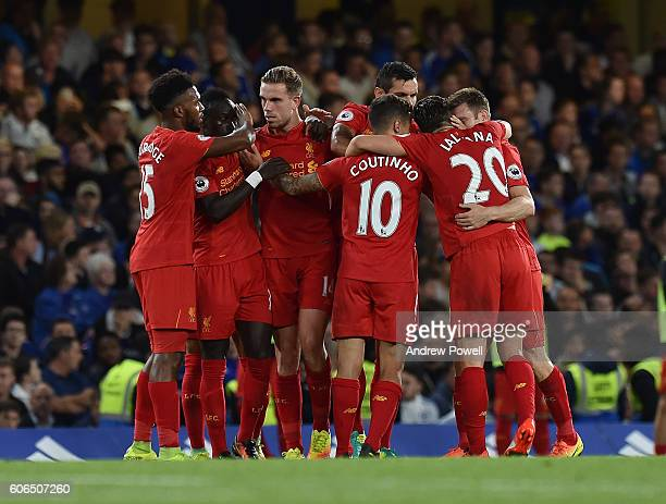 Jordan Henderson of Liverpool scores the second goal for liverpool and celebrates during the Premier League match between Chelsea and Liverpool at...