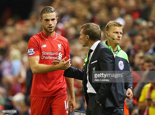 Jordan Henderson of Liverpool shakes hands with Brendan Rodgers manager of Liverpool as he is substituted during the Barclays Premier League match...
