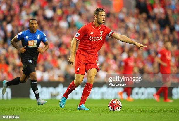 Jordan Henderson of Liverpool signals as he runs with the ball during the Barclays Premier League match between Liverpool and AFC Bournemouth at...