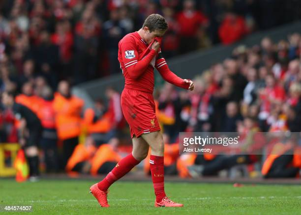Jordan Henderson of Liverpool walks off after being shown a red card by Referee Mark Clattenburg during the Barclays Premier League match between...