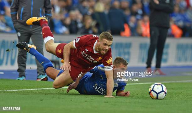Jordan Henderson of Liverpool with Marc Albrighton of leicester during the Premier League match between Leicester City and Liverpool at The King...