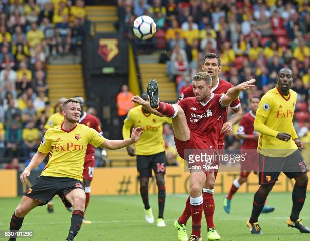 Jordan Henderson of Liverpool With Tom Cleverley during the Premier League match between Watford and Liverpool at Vicarage Road on August 12 2017 in...
