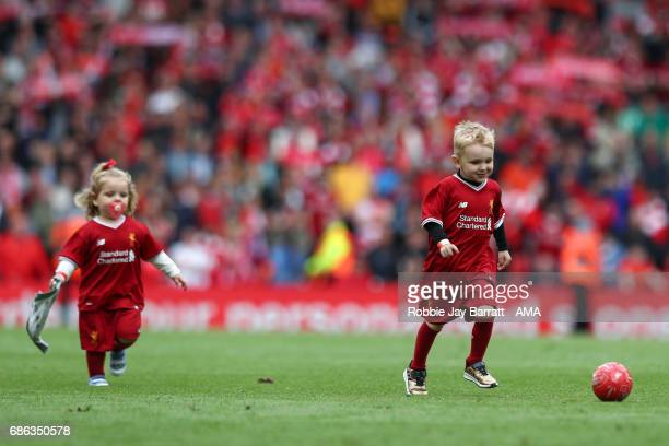 Jordan Henderson of Liverpool's children on the pitch at full time during the Premier League match between Liverpool and Middlesbrough at Anfield on...