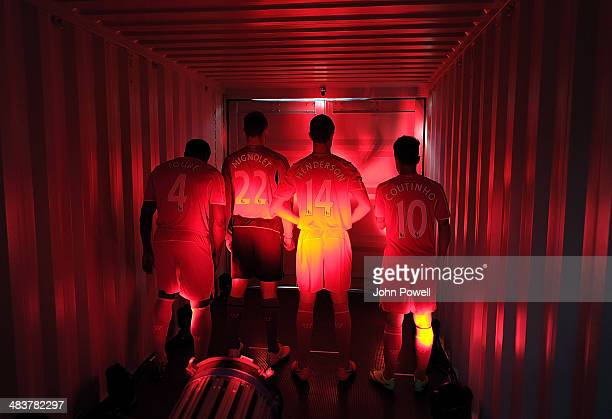 Jordan Henderson Philippe Coutinho Simon Mignolet and Kolo Toure of Liverpool before they present the new home kit for next season at Liverpool One...