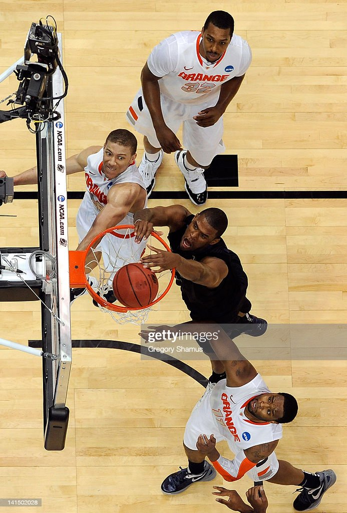 Jordan Henriquez of the Kansas State Wildcats dunks against Kris Joseph Brandon Triche and Scoop Jardine of the Syracuse Orange during the third...