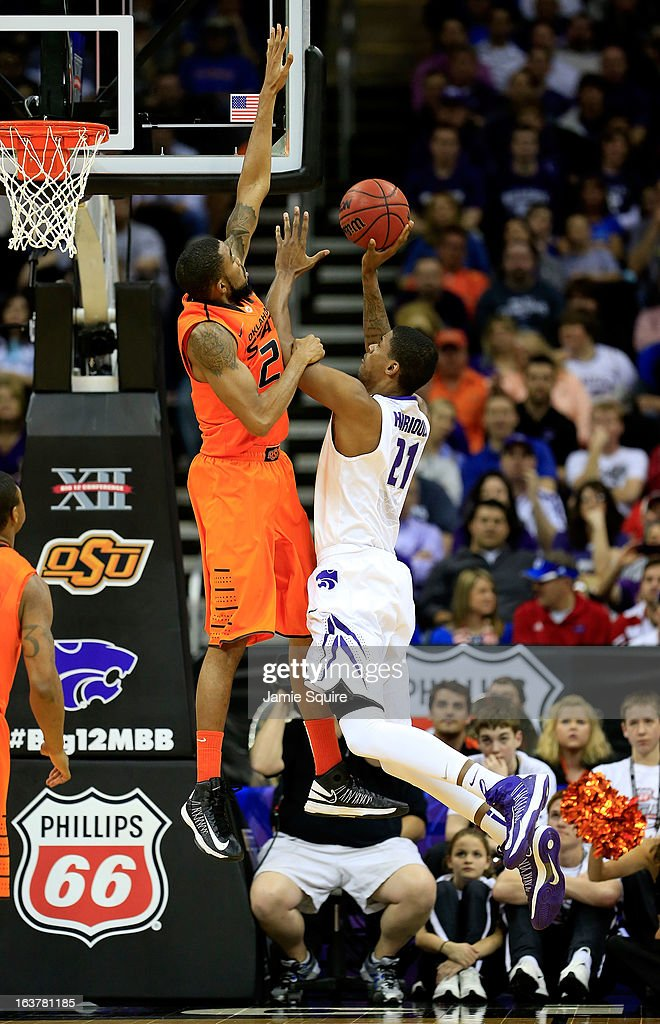 Jordan Henriquez #21 of the Kansas State Wildcats shoots against Michael Cobbins #20 of the Oklahoma State Cowboys the first half during the Semifinals of the Big 12 basketball tournament at the Sprint Center on March 15, 2013 in Kansas City, Missouri.