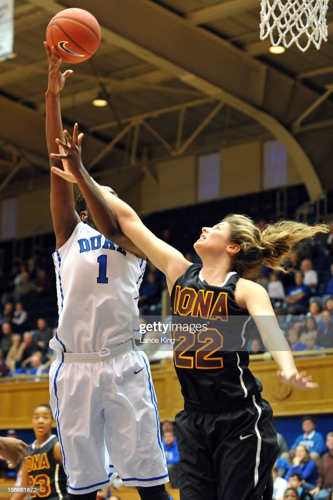Jordan Henry #22 of the Iona Gaels defends a shot by Elizabeth Williams #1 of the Duke Blue Devils at Cameron Indoor Stadium on November 18, 2012 in Durham, North Carolina.