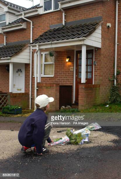 Jordan Hill aged eight leaves flowers outside the house in Colmworth close Reading where 2 children were killed in a car fire The children a girl...