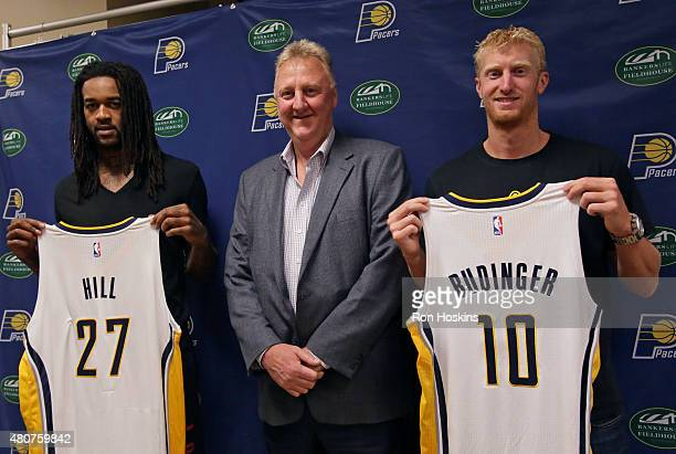 Jordan Hill and Chase Budinger of the Indiana Pacers are introduced to the media by Pacers President Larry Bird at Bankers Life Fieldhouse on July 14...