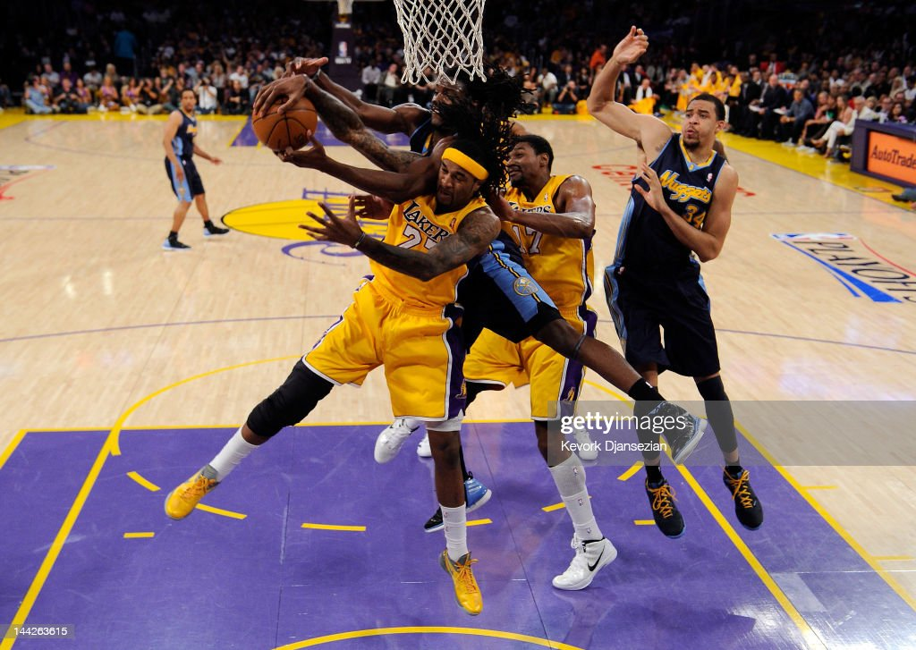 Jordan Hill of the Los Angeles Lakers and Kenneth Faried of the Denver Nuggets battle for a rebound under the basket in the first half in Game Seven...