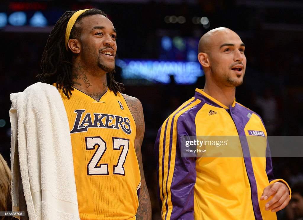 Jordan Hill #27 of the Los Angeles Lakers and Robert Sacre #50 react to the dunk of Xavier Henry #7 during a 116-95 win over the New Orleans Pelicans at Staples Center on November 12, 2013 in Los Angeles, California.