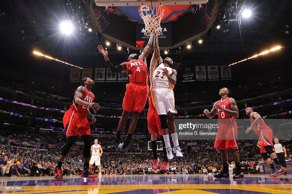 <a gi-track='captionPersonalityLinkClicked' href=/galleries/search?phrase=Jordan+Hill+-+Basketball+Player&family=editorial&specificpeople=13503530 ng-click='$event.stopPropagation()'>Jordan Hill</a> #27 of the Los Angeles Lakers attempts a shot against <a gi-track='captionPersonalityLinkClicked' href=/galleries/search?phrase=Paul+Millsap&family=editorial&specificpeople=880017 ng-click='$event.stopPropagation()'>Paul Millsap</a> #4 of the Atlanta Hawks on November 3, 2013 at STAPLES Center in Los Angeles, California.