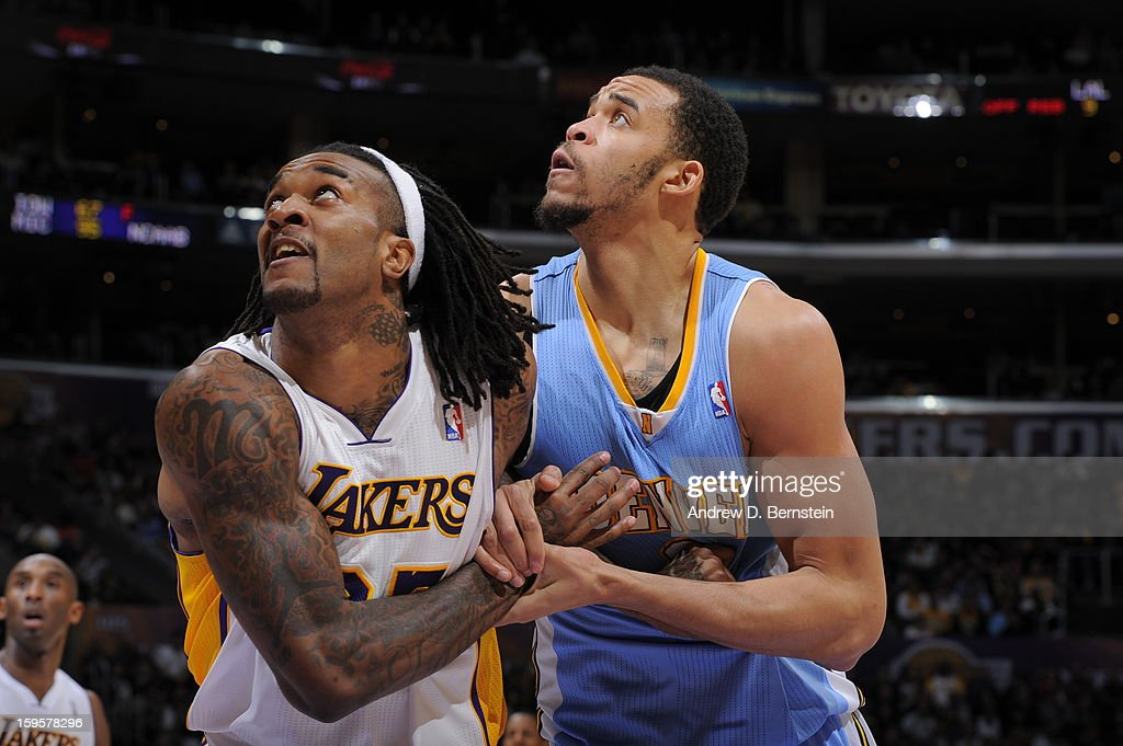 Jordan Hill #27 of the Los Angeles Lakers boxes out JaVale McGee #34 of the Denver Nuggets at Staples Center on January 6, 2013 in Los Angeles, California.