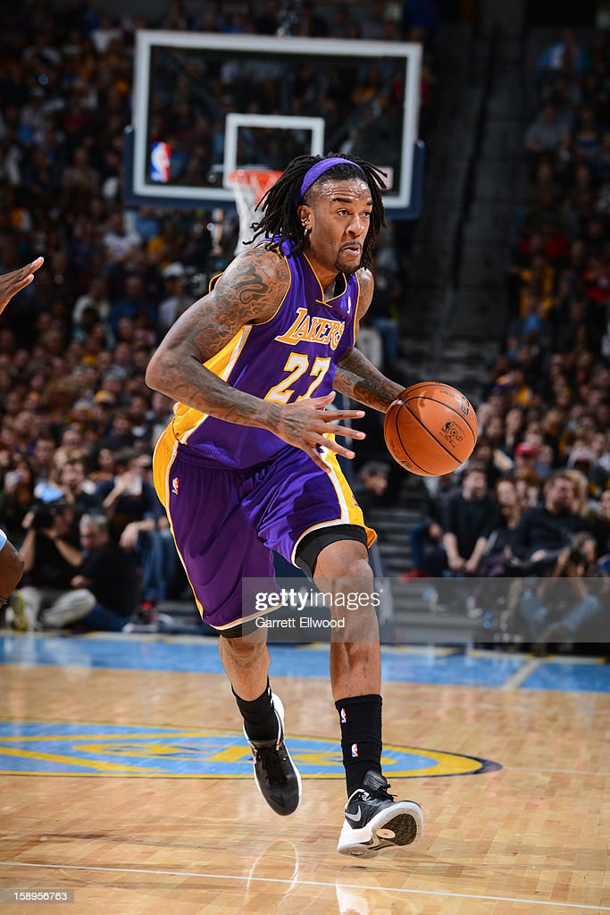 <a gi-track='captionPersonalityLinkClicked' href=/galleries/search?phrase=Jordan+Hill+-+Basketspelare&family=editorial&specificpeople=13503530 ng-click='$event.stopPropagation()'>Jordan Hill</a> #27 of the Los Angeles Lakers drives to the basket against the Denver Nuggets on December 26, 2012 at the Pepsi Center in Denver, Colorado.