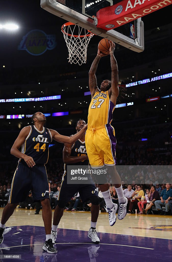 <a gi-track='captionPersonalityLinkClicked' href=/galleries/search?phrase=Jordan+Hill+-+Basketball+Player&family=editorial&specificpeople=13503530 ng-click='$event.stopPropagation()'>Jordan Hill</a> #27 of the Los Angeles Lakers drives to the basket for a dunk over <a gi-track='captionPersonalityLinkClicked' href=/galleries/search?phrase=Brian+Cook+-+Basketball+Player&family=editorial&specificpeople=202839 ng-click='$event.stopPropagation()'>Brian Cook</a> (L) #44 and <a gi-track='captionPersonalityLinkClicked' href=/galleries/search?phrase=Derrick+Favors&family=editorial&specificpeople=5792014 ng-click='$event.stopPropagation()'>Derrick Favors</a> #15 of the Utah Jazz in the second half at Staples Center on October 22, 2013 in Los Angeles, California. The Lakers defeated the Jazz 108-94.