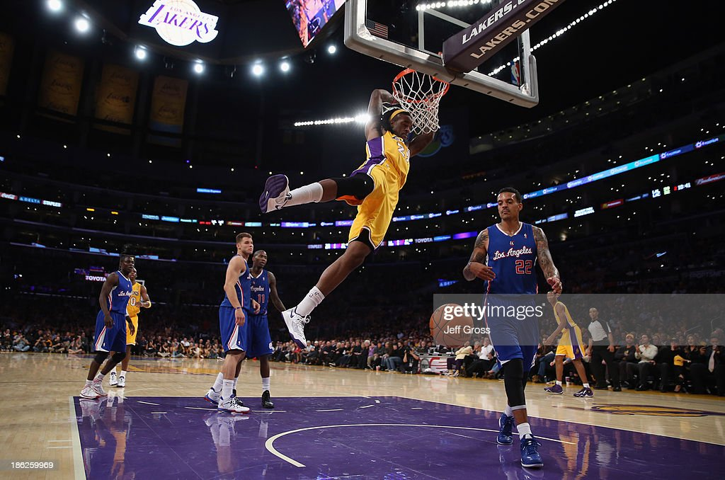 <a gi-track='captionPersonalityLinkClicked' href=/galleries/search?phrase=Jordan+Hill+-+Basketballer&family=editorial&specificpeople=13503530 ng-click='$event.stopPropagation()'>Jordan Hill</a> #27 of the Los Angeles Lakers dunks over <a gi-track='captionPersonalityLinkClicked' href=/galleries/search?phrase=Matt+Barnes+-+Basketballer&family=editorial&specificpeople=202880 ng-click='$event.stopPropagation()'>Matt Barnes</a> #22 of the Los Angeles Clippers in the first half at Staples Center on October 29, 2013 in Los Angeles, California.