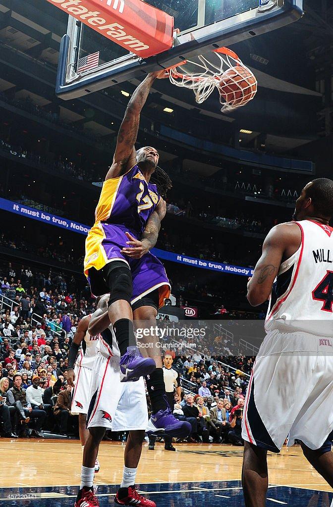 Jordan Hill #27 of the Los Angeles Lakers dunks the ball against the Atlanta Hawks on December 16, 2013 at Philips Arena in Atlanta, Georgia.