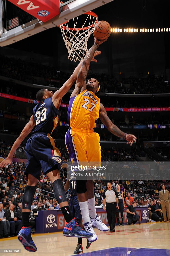 Jordan Hill #27 of the Los Angeles Lakers goes up for a dunk against Anthony Davis #23 of the New Orleans Pelicans at Staples Center on November 12, 2013 in Los Angeles, California.