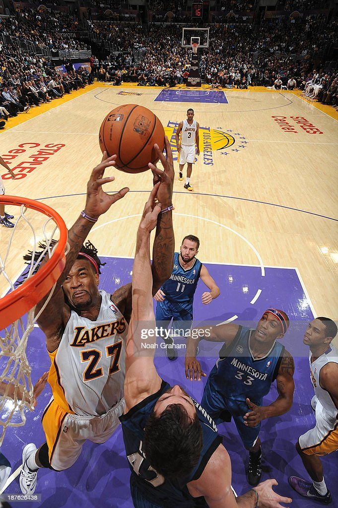 <a gi-track='captionPersonalityLinkClicked' href=/galleries/search?phrase=Jordan+Hill+-+Basketball+Player&family=editorial&specificpeople=13503530 ng-click='$event.stopPropagation()'>Jordan Hill</a> #27 of the Los Angeles Lakers goes up for a shot against <a gi-track='captionPersonalityLinkClicked' href=/galleries/search?phrase=Kevin+Love&family=editorial&specificpeople=4212726 ng-click='$event.stopPropagation()'>Kevin Love</a> #42 of the Minnesota Timberwolves at Staples Center on November 10, 2013 in Los Angeles, California.