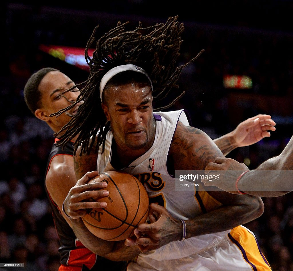 <a gi-track='captionPersonalityLinkClicked' href=/galleries/search?phrase=Jordan+Hill+-+Basketball+Player&family=editorial&specificpeople=13503530 ng-click='$event.stopPropagation()'>Jordan Hill</a> #27 of the Los Angeles Lakers grabs a rebound in front of DeMar DeRozan #10 of the Toronto Raptors at Staples Center on December 8, 2013 in Los Angeles, California.