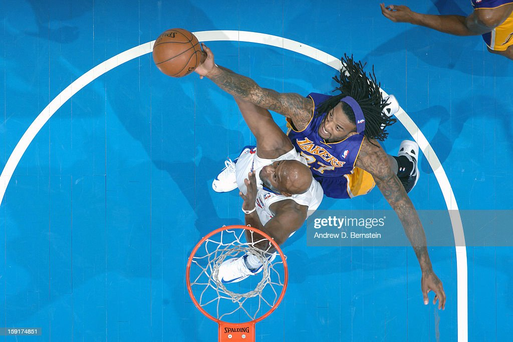 Jordan Hill #27 of the Los Angeles Lakers grabs a rebound the Los Angeles Clippers at Staples Center on January 4, 2013 in Los Angeles, California.