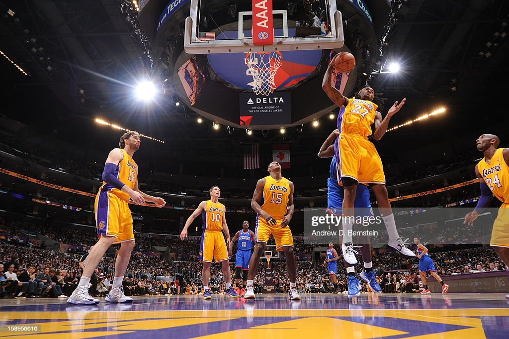 Jordan Hill #27 of the Los Angeles Lakers grabs the rebound against the Philadelphia 76ers at Staples Center on January 1, 2013 in Los Angeles, California.