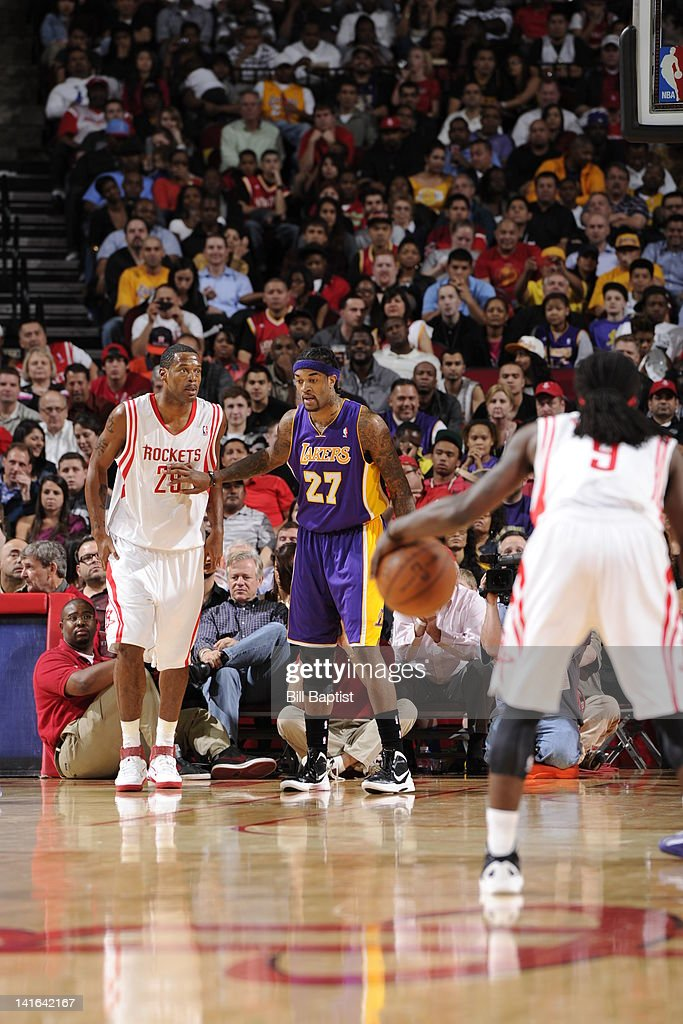Jordan Hill of the Los Angeles Lakers guards Marcus Camby of the Houston Rockets during the game between the Houston Rockets and the Los Angeles...