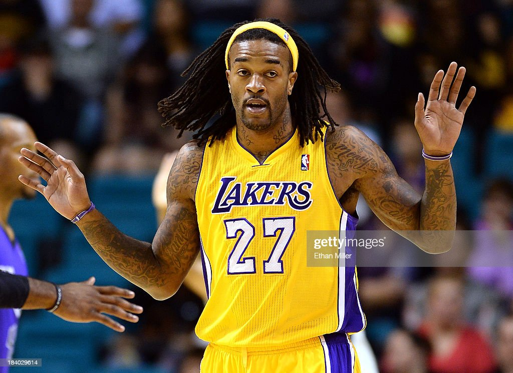 Jordan Hill #27 of the Los Angeles Lakers reacts to an official's call during a preseason game against the Sacramento Kings at the MGM Grand Garden Arena on October 10, 2013 in Las Vegas, Nevada. Sacramento won 104-86.
