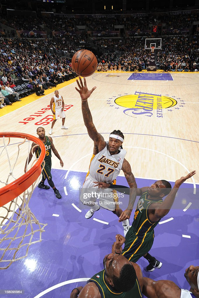 <a gi-track='captionPersonalityLinkClicked' href=/galleries/search?phrase=Jordan+Hill+-+Basketball+Player&family=editorial&specificpeople=13503530 ng-click='$event.stopPropagation()'>Jordan Hill</a> #27 of the Los Angeles Lakers shoots against <a gi-track='captionPersonalityLinkClicked' href=/galleries/search?phrase=Paul+Millsap&family=editorial&specificpeople=880017 ng-click='$event.stopPropagation()'>Paul Millsap</a> #24 of the Utah Jazz at Staples Center on December 9, 2012 in Los Angeles, California.