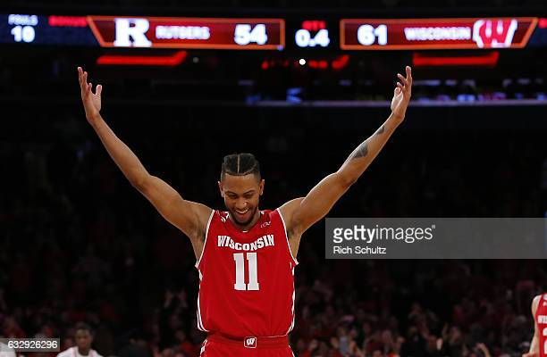 Jordan Hill of the Wisconsin Badgers celebrates their 6154 overtime win over the Rutgers Scarlet Knights in an NCAA college basketball game at...