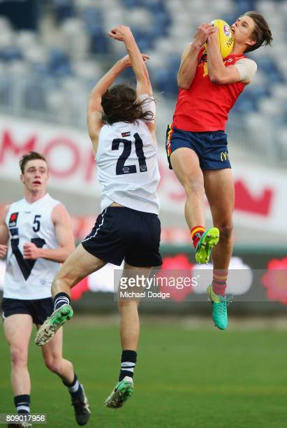 Jordan Houlihan of South Australia marks the ball against against Hunter CLARK of Vic Country during the U18 AFL Championships match between Vic...