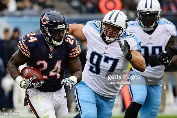 Jordan Howard of the Chicago Bears carries the football against Karl Klug of the Tennessee Titans in the second quarter at Soldier Field on November...