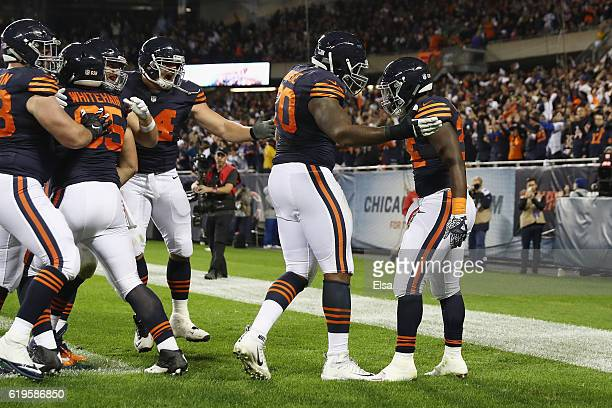Jordan Howard of the Chicago Bears celebrates with teammates after scoring a touchdown during the second quarter against the Minnesota Vikings at...