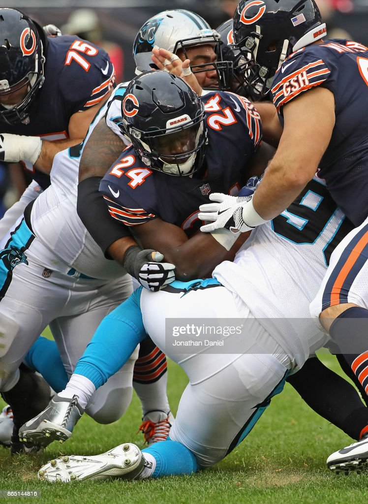 Jordan Howard #24 of the Chicago Bears is stopped short of the goal by Star Lotulelei and Julius Peppers #90 of the Carolina Panthers at Soldier Field on October 22, 2017 in Chicago, Illinois. The Bears defeated the Panthers 17-3.