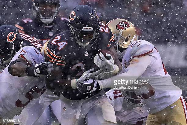 Jordan Howard of the Chicago Bears is tackled by Gerald Hodges and Jimmie Ward of the San Francisco 49ers after running for a first down at Soldier...