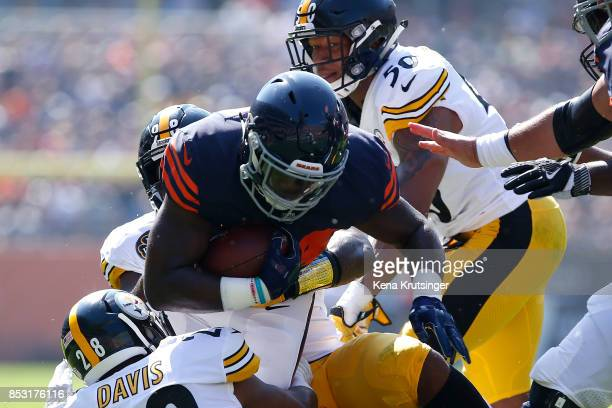 Jordan Howard of the Chicago Bears is tackled by Vince Williams of the Pittsburgh Steelers in the first quarter at Soldier Field on September 24 2017...