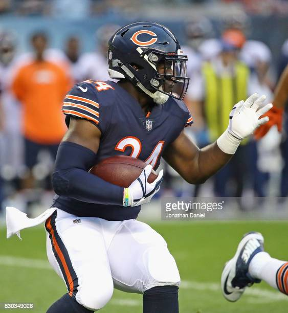 Jordan Howard of the Chicago Bears runs against the Denver Broncos during a preseason game at Soldier Field on August 10 2017 in Chicago Illinois The...