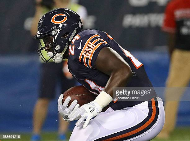 Jordan Howard of the Chicago Bears runs against the Denver Broncos at Soldier Field on August 11 2016 in Chicago Illinois The Broncos defeated the...